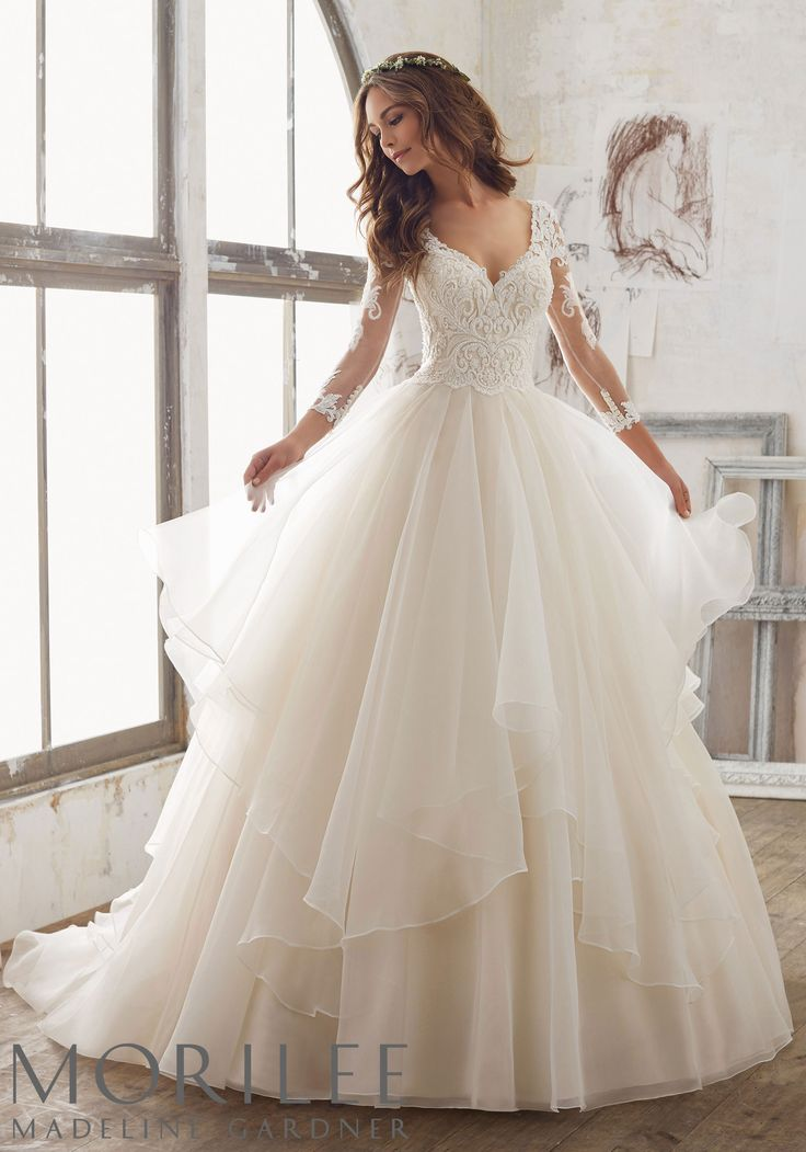 """Morilee by Madeline Gardner """"Maya"""" Style 5517   Breathtaking Beauty Best Describes This Stunning Ballgown. Delicately Beaded, Alençon Lace AppliquŽés Adorn the Bodice and Illusion Sleeves, While Layers of Organza Create A Soft Dreamy Skirt."""