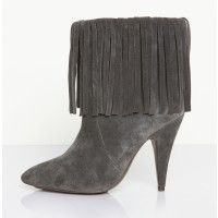 Kathryn Amberleigh fringe boot in grey suede features heeled high ankle boot with surrounding fringe detail, styled with boot front lapel – find it online at TheDreslyn.com; free shipping and handling