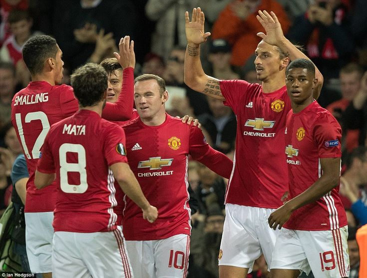 United's captain on the night, Chris Smalling (left) congratulates Ibrahimovic on his goal...