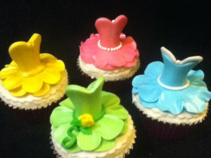 Princess Dress Cupcakes on Cake Lane  Easy to make, easy to customize!  I need to make more of the princesses next time.  Tiana, Aurora, Belle, and Cinderella.
