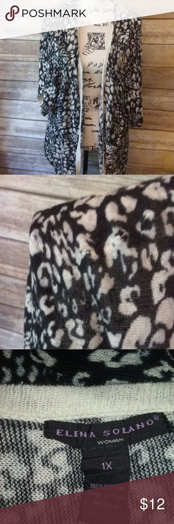 """Elena Solando Woman Leopard Cardigan Size 1X Lightweight black and white leopard print cardigan, comes to long points in the front.  Made by Elena Solando Woman, size 1X, measures approximately 36"""" long from back collar to longest front point and 18.5"""" underarm to underarm. Elena Solando Woman Sweaters Cardigans"""