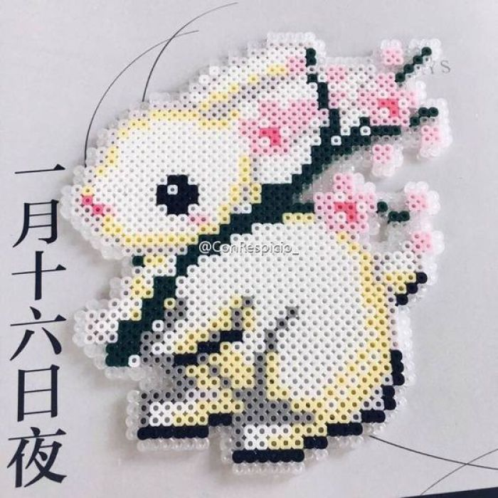 Really cute bunny with cherry blossoms. Think you could cross stitch this.