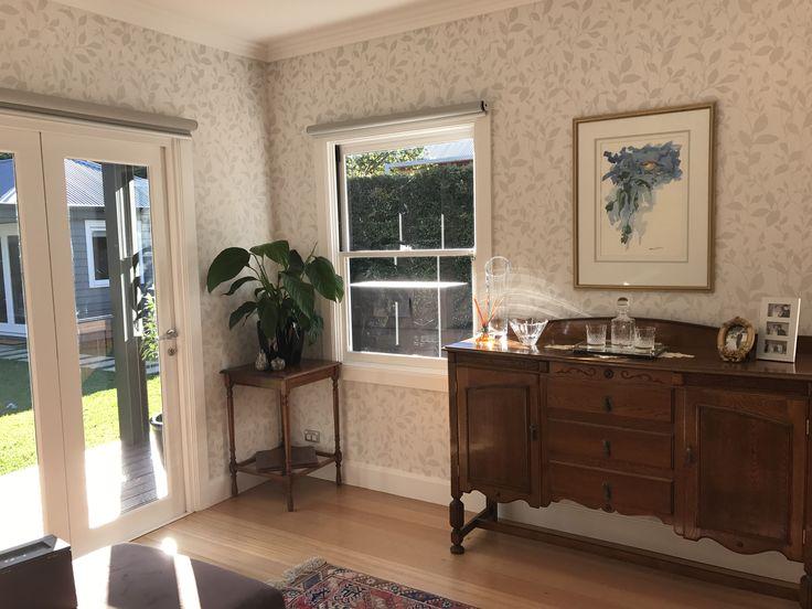 Light filled sitting room.  Wallpaper, traditional furniture. White trims.  Lisa Banducci Design.