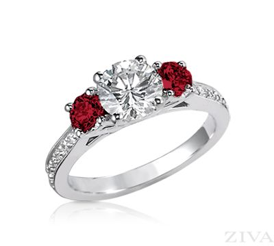 I frickin love it. I want white gold. I want a heart shaped diamond with rubies on the side like this. The band can be plain or be like the eternity bands.