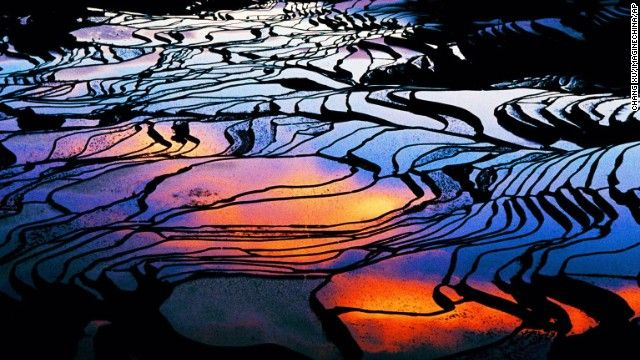 The mirrorlike pools of Yuanyang County's flooded rice terraces in China's Yunnan province allow for an array of intense visual effects. Ancestors of the Hani people crafted the terraces by hand more than 1,000 years ago to irrigate the red rice crop. The terraces change with the seasons; in the winter and spring, flooded paddies create reflective pools, which give way to rippling ribbons of bold green in the summer growing season.