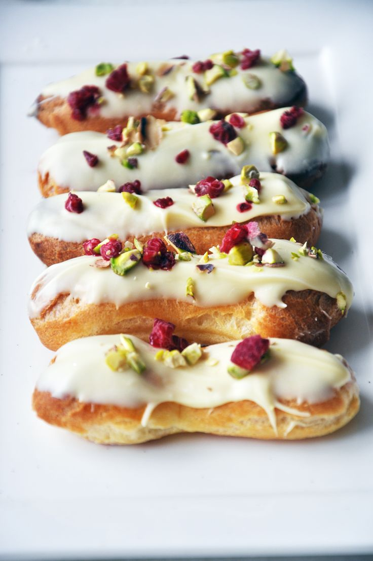 Apple 2 the Pie . White chocolate French Eclairs . { so pretty . choux pastry loveliness . with a white chocolate, raspberry & pistachio topping . the Great British Bake Off 2015 . Episode8 . showstopper } .