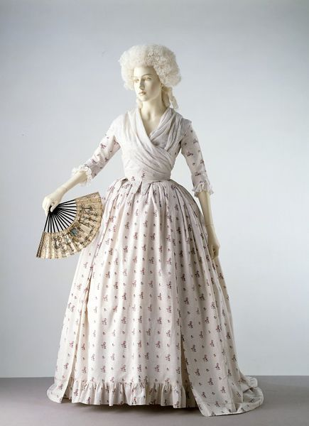 "Robe à l'anglaise: ca. 1785, British, printed cotton, lined with linen; hand-sewn. ""In the 1770s and 1780s printed cotton fabrics began to replace silk in popularity for women's gowns. The material of this gown has a dotted ground and is printed in a repeating pattern of floral sprays. The gown has a fitted back and open front below the waist, revealing a petticoat of the same fabric..."""