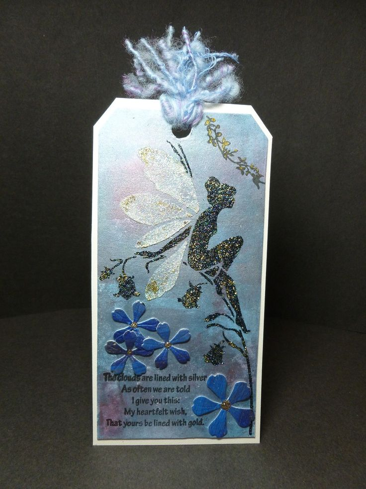 'Bluebell Fairy' Tag. - Imagination Craft's - Black Stars, Diamond & Gold shine Sparkle Mediums.  Bluebell fairy stencil.  Metal spatula.   Brayer.  Mediterranean sky, Sax blue,  Dried rose & White gold Starlight paints.   Flower dies - Memory Box.  Sentiment & leaf stem - Lavinia.   October 2016.  Designed by Jennifer Johnston.