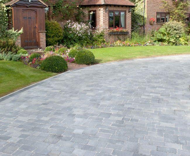 This rustic block paved driveway features Brett 60mm Alpha Trio block paving bricks in a subtle Silver Haze colour