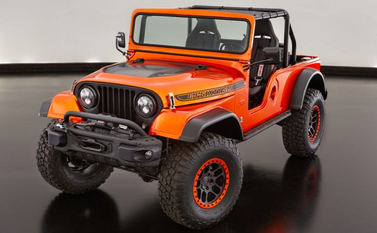 Jeep just dropped a 1966 Jeep CJ body onto a second-gen Wrangler frame, bolted on some modern Wrangler bumpers and threw in some Dodge Viper seats. The result is a true masterpiece.