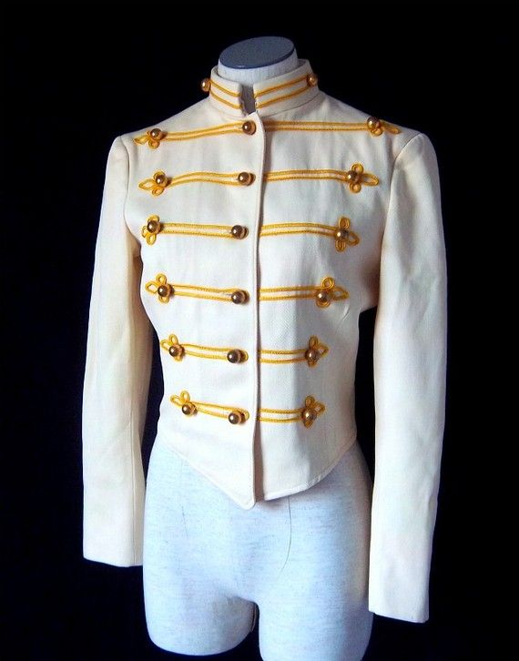 Oh Lordy! Love this gorgeous military cut band jacket. Beautiful cream wool with gold brocade trim and dome goldtone buttons.  Fully lined in cream
