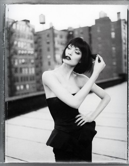 * black and white photo of shalom harlow.                                                                                                                                                                                 More