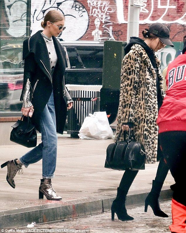 Sticking together:Gigi Hadid spent the day with sister Bella in New York on Tuesday no doubt trying to keep her younger sibling's mind off her ex