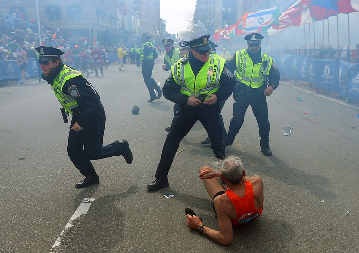 April 15, 2013 — Boston Marathon bombing | The 50 Most Powerful Pictures In American History. Later it was reported this runner was scared & fell.  Explosion, itself, did not knock this man to ground as news media reported.
