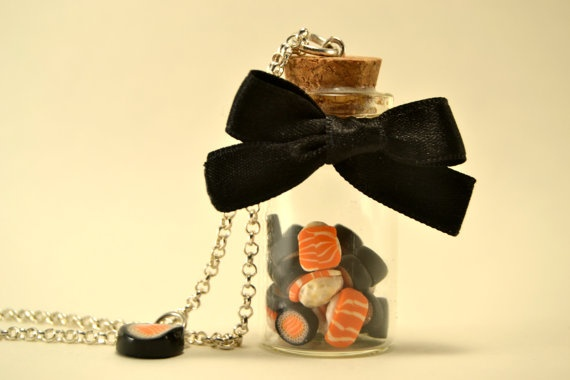 long necklace with mini bottle filled with sushi and a bow  long necklace with mini bottle filled with sushi and a bow     this is a long necklace (76cm) with a glass bottle (2cm wide and 4,5cm tall) filled with small sushi .  there's a small sushi charms hanged on the chain.  a black bow is tided around the bottle <3