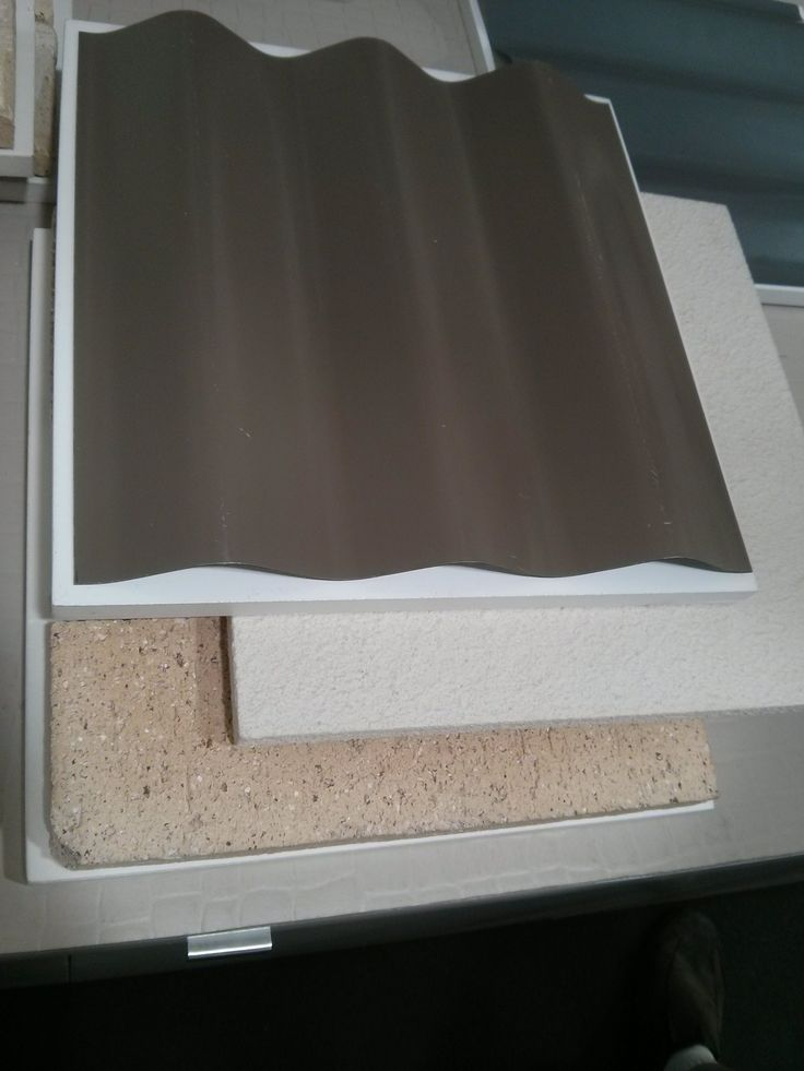 Jasper Colorbond Roof + Grand piano cladding + Sand dune brick