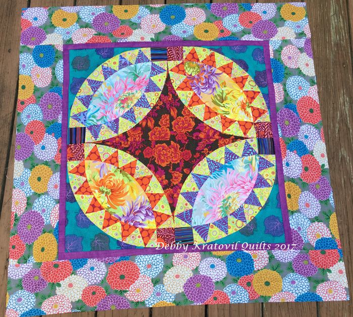 """Added borders to my Kaffe Pickle Dish quilt. Pretty wild but also happy colors to make anyone smile. Measures 36"""" x 36"""". Hope to quilt it asap."""