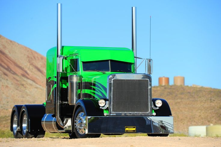 It's not so much the graphics that capture the attention as it is the color combo of Wes Malmgren's Peterbilt 379. The black and lime green flattop, an in-house build done at the Malmgren family's company headquarters in Aurora, Utah, is the rebel amongst a fleet of more refined workhorses. For full story, visit www.customrigsmag.com/wicked-green