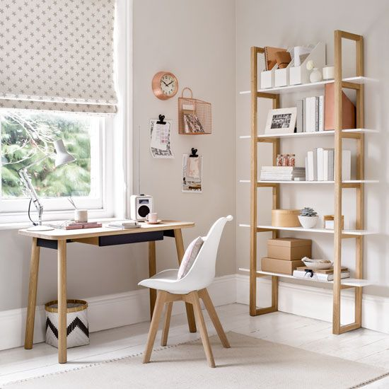 Pale grey home office with compact desk and utility shelving