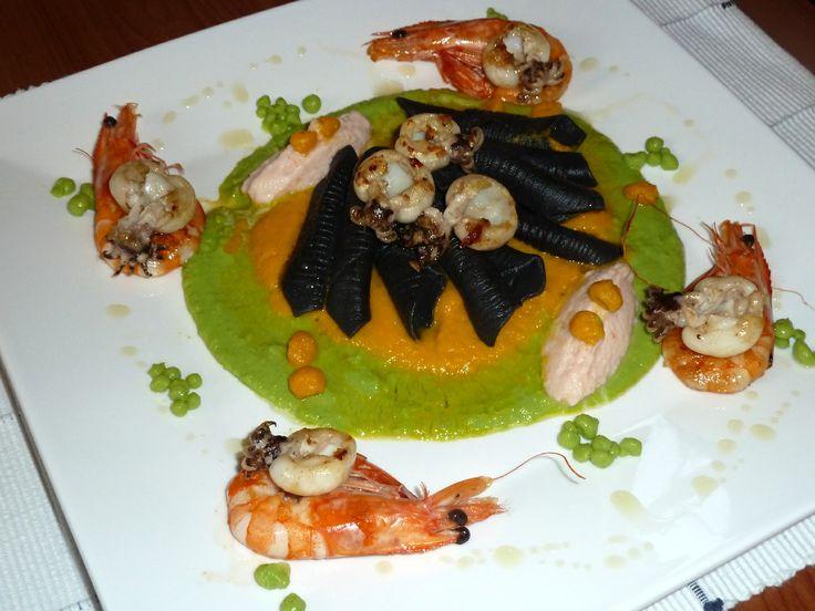 garganelli nero di sepia - home made - su fondo di piselli e carote con quenelle di calamaretti