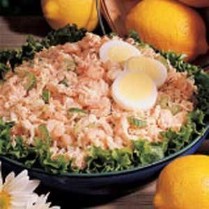 Texas Seafood Salad.  Ingredients:    1 pound cooked medium shrimp  3 cups cooked or canned crabmeat, drained, flaked and cartilage removed  1 small onion, chopped  1 celery rib, thinly sliced  1/2 cup mayonnaise  2 teaspoons seafood seasoning  1 teaspoon lemon juice  1/2 teaspoon salt  1/8 teaspoon pepper  Leaf lettuce, optional  1 hard-cooked egg, sliced, optional