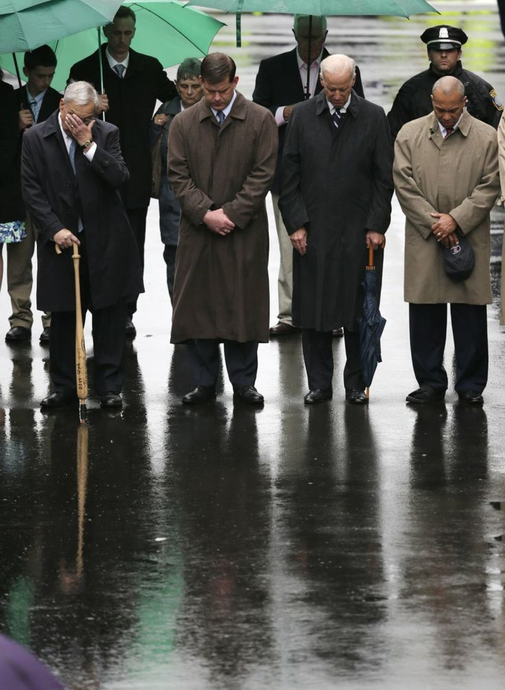 Former Boston Mayor Tom Menino, Boston Mayor Martin Walsh, Vice President Joe Biden and Mass. Gov. Deval Patrick lower their heads for a moment of silence during a tribute in honor of the one year anniversary of the Boston Marathon bombings, Tuesday, April 15, 2014 in Boston. #BostonStrong