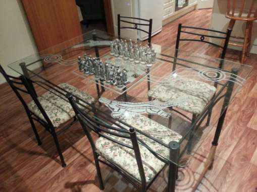 Engraved Kitchen Table - A glass table top engraved with a chess board and a running waterhole. It also has two large platypus engraved on e...