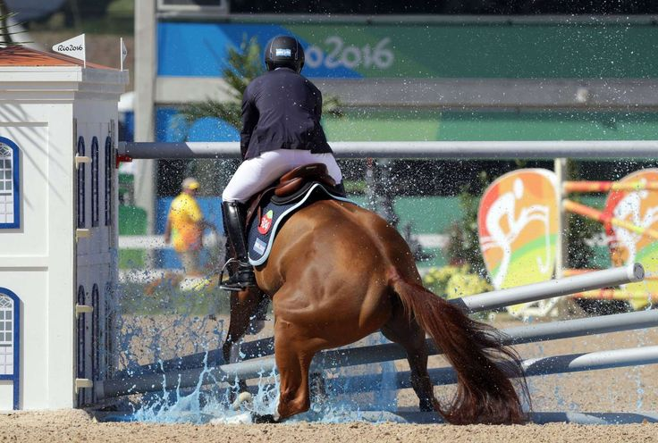 Best images from Aug. 14 at the Rio Olympics:      Ramiro Quiantana of Argentina aboard Appy Cara miss a jump during the equestrian open jumping qualification in the Rio 2016 Summer Olympic Games at Olympic Equestrian Centre.