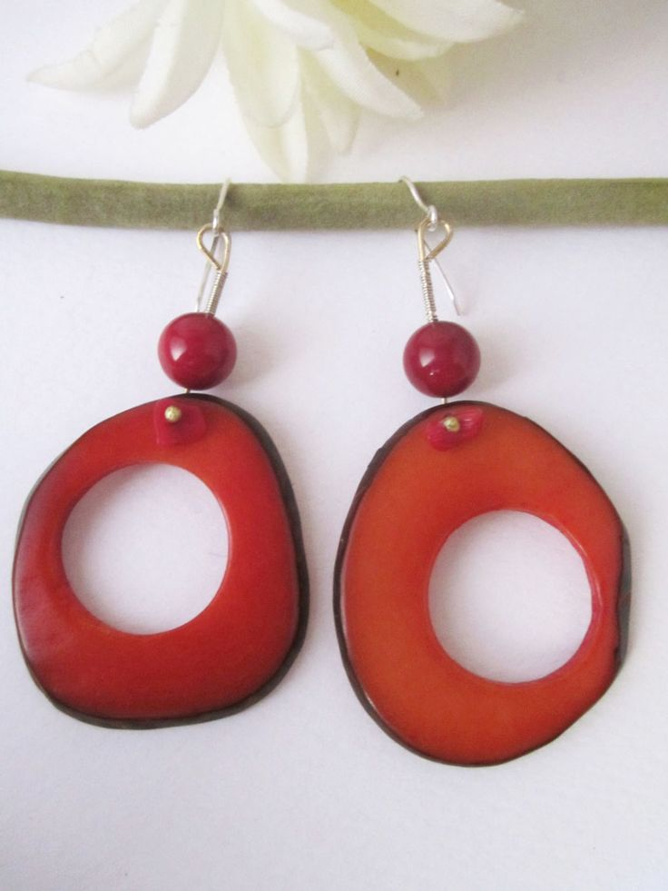 Orange dangle vegetable ivory nut earrings with donut shape, and red coral - silver hook by NataliaNorenasilver on Etsy