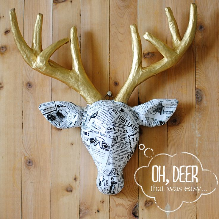 A cardboard deer transformation with gold spray paint