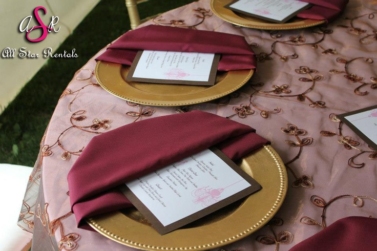 Another unique way to incorporate your wedding colors into your place settings! Try a charger plate with our half moon napkin fold :)