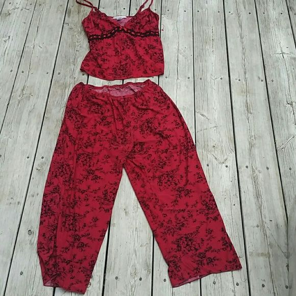 California Dynasty Women's PJ Set Size Medium California Dynasty Women's PJ Set Size Medium  90% Polyester 10% Spandex  Really pretty, and feminine Red with black detailing. Feels like silk No trades  No off-site transactions  * Price ABSOLUTELY FIRM unless you bundle * California Dynasty  Intimates & Sleepwear Pajamas