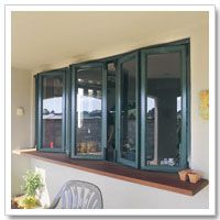 Bifold windows and pretty wooden bar (benchtop)