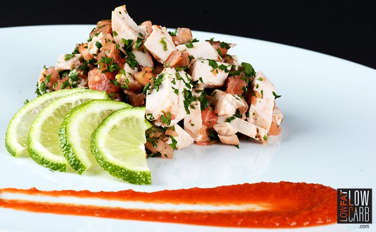 To begin, season chicken cubes with sea salt and pepper to taste.Now, in a small bowl, mix together chicken, tomatoes, basil and lime.Top it off with tomato coulis.Ready to serve!
