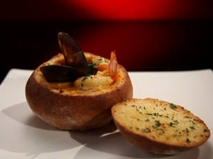 Seafood chowder served in a cob loaf - love the idea of serving in a cob loaf