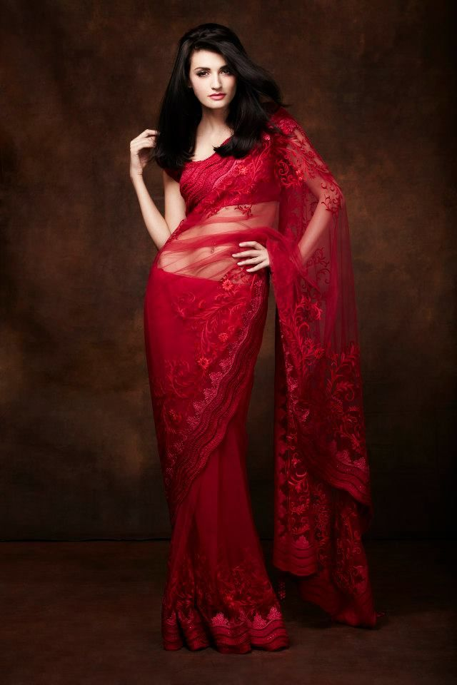 What's better than a red lacy saree? A black one... But this is sexy! I need it!