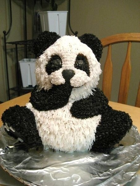 I soo want this for Brittany's bday. 3D+Panda+Bear+-+3D+Panda+Bear+using+Wilton+3D+Bear+pan.++I+used+grass+tip+233+for+white+fur+except+the+muzzle+and+between+eyes+I+used+star+tip.++I+used+star+tip+for+all+of+the+black.