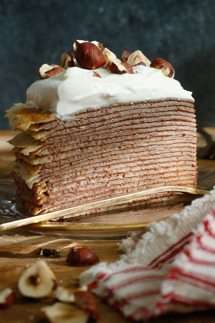 NYT Cooking: Something magical happens when you layer crepes with cream to build a cake. The flavors intensify, you improve the cream to crepe ratio and there are more crispy edges. And then there is the dazzling moment when you present the ethereal cake and slice into it to reveal a whole world of fine rings. This cake, with light hazelnut crepes and rich chocolate cream, isn't%...