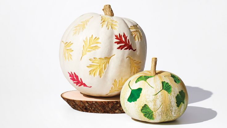 Take a leaf out of our book and dress up your pumpkins with elegant etched designs. They may look fancy, but they're actually basic watercolors brushed over linocut carvings. We love the contrast of the paints on white, but the patterns will look striking on any pumpkin you happen to pick.