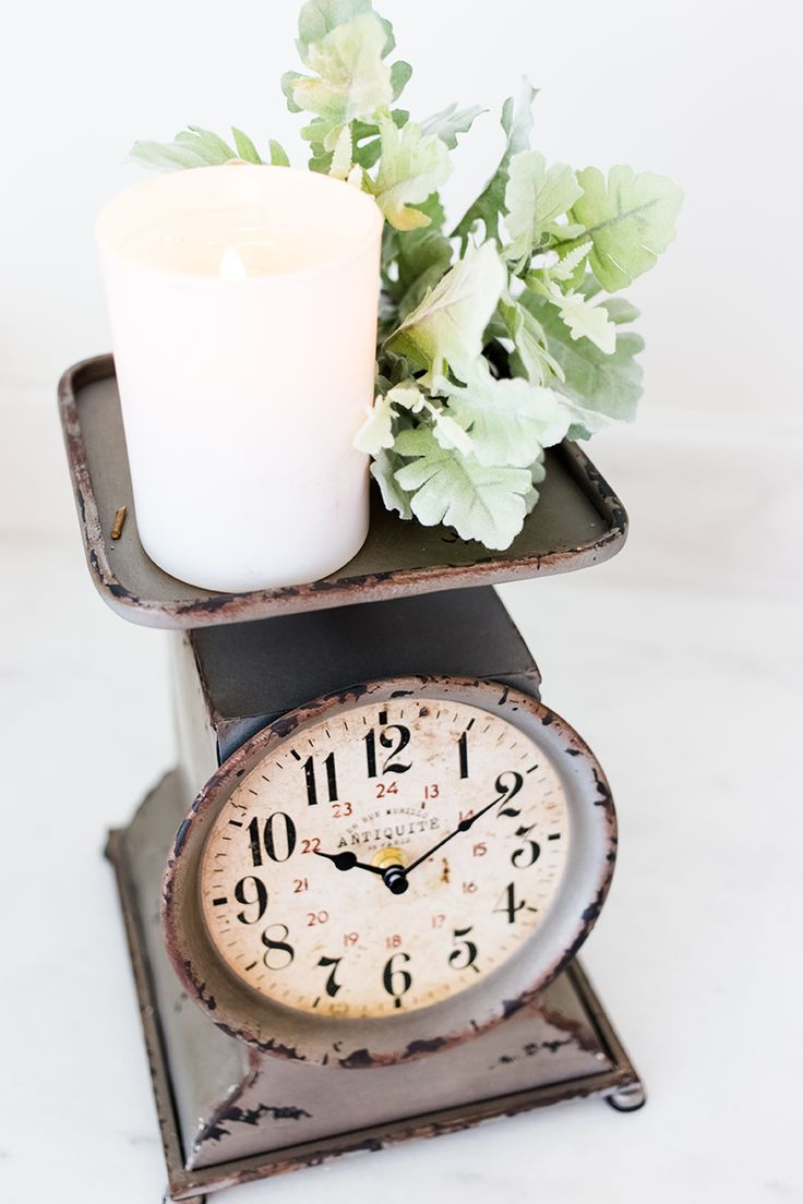 Vintage scales have always been popular with collectors, but both old and new scales are used today in home decor. Since we have much more precise ways to weigh our food and babies, the reproductions use a clock face in place of the weight display.