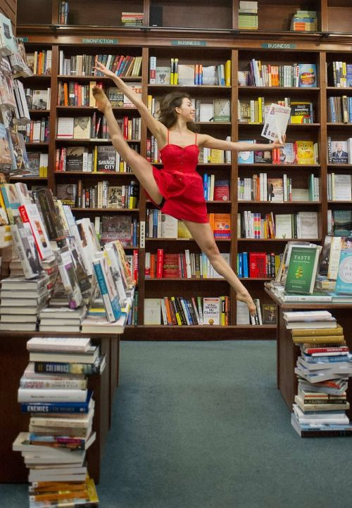 Dancer in bookstore, reading while dancing. From Dancers Among Us: A Celebration…