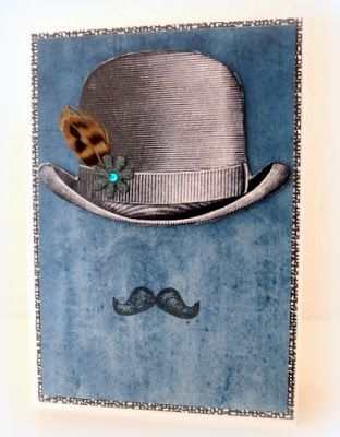 Bowler hat with feather, black paper flower and stamped moustache _ Moski
