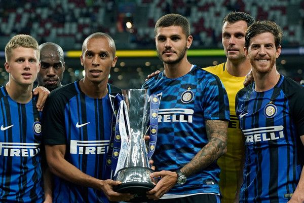 Mauro Icardi of  FC Internazionale leads his team-mates to celebrate with the Champions Trophy after they defeated Chelsea FC 2-1 during the International Champions Cup match between FC Internazionale and Chelsea FC at National Stadium on July 29, 2017 in Singapore.