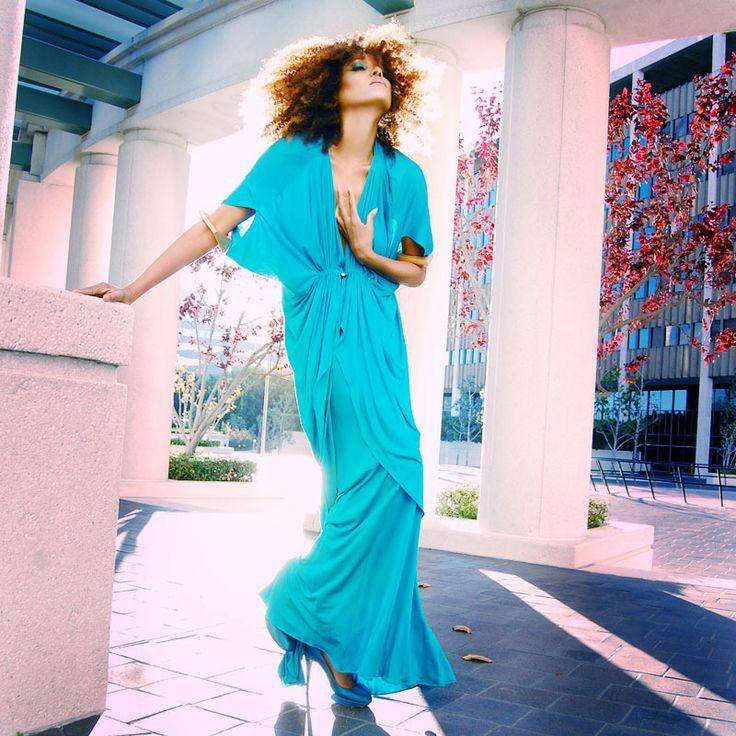 Ndoema The Global Girl wears a BodyAmr goddess-inspired draped dress and Nicholas Kirkwood satin shoes.