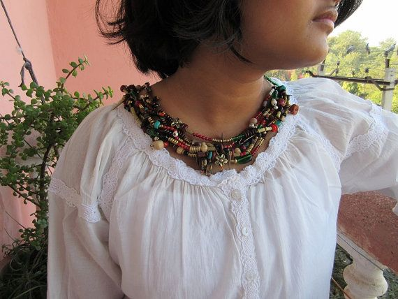 Multi-stranded beaded boho tribal necklace        # Item is handmade using anchor cotton thread, wooden beads, glass beads, semi-precious stones,