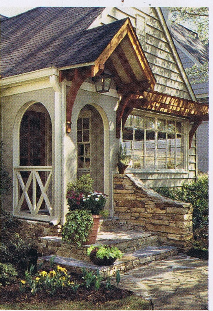 Lovely little portico and beautiful picture window -- very inviting entry with shallow stone steps.