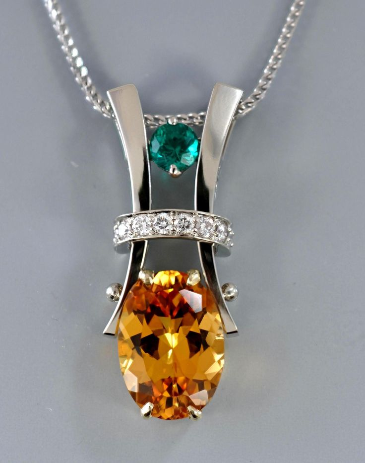 Imperial #topaz with #emerald and diamonds in while gold by Alex Gulko