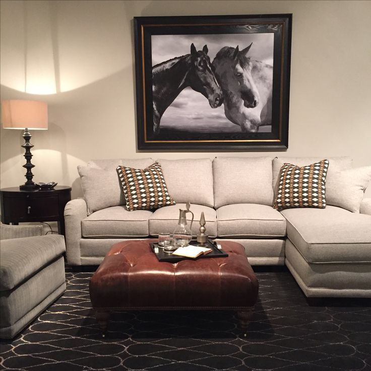 ottoman for living room%0A Adding a leather ottoman and a dark rug to a classic custom sectional helps  make a stunning living roo