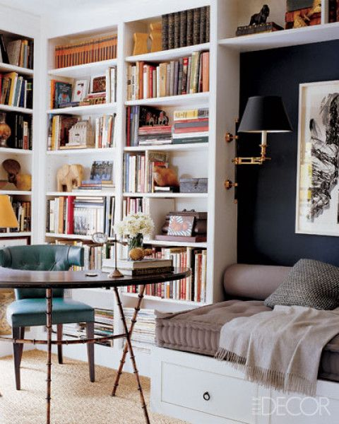 Sensational room:  in-love w/black wall against white built-ins + day bed; sisal rug; bookshelves on multiple walls + over day bed; love taupe fabric on daybed; arrangement of books and items on shelves; reading lamps