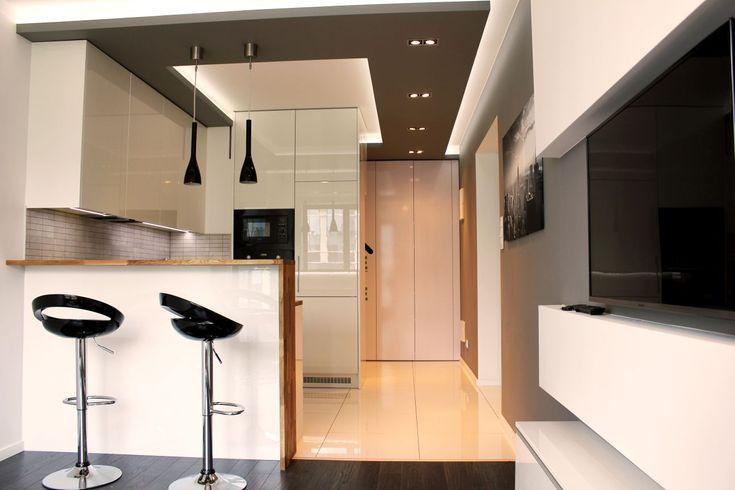 Kuchnia na wymiar do kawalerki Small kitchen together with livingroom